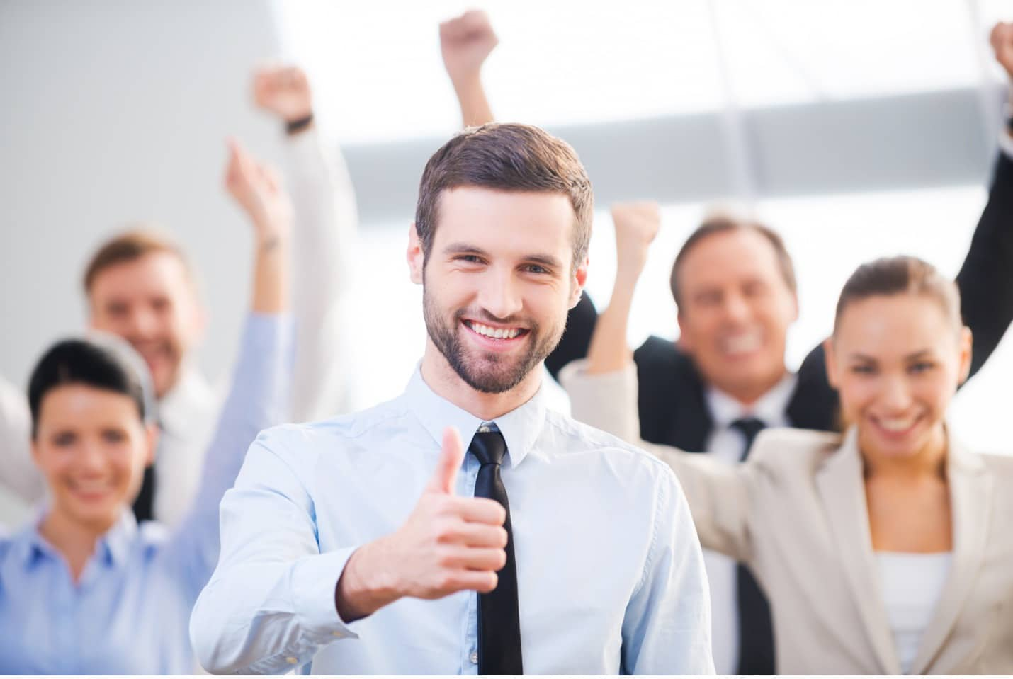 Young Man giving you a thumbs up in the office
